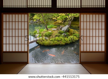 Sliding Japanese doors and fish pond with colorful orange carp swimming in the water - stock photo