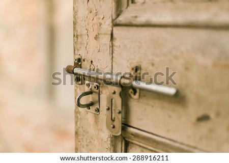 Sliding lock with wood door - stock photo