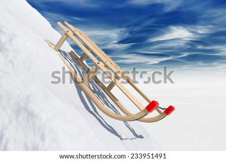 Sliding sledge in snow on a sky background - stock photo