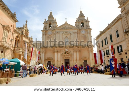 SLIEMA, MALTA - APRIL 19: The Mdina medieval festival and tourists on April 19, 2015 in Mdina, Malta. More then 1,6 mln tourists is expected to visit Malta in year 2015. - stock photo