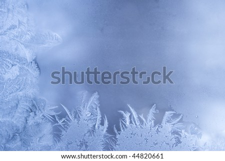 Slightly blurred beautiful frostwork on a window glass (with empty space for your text or image) - stock photo