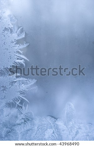 Slightly blurred beautiful frostwork on a window glass (with empty space on the right for your text or image) - stock photo