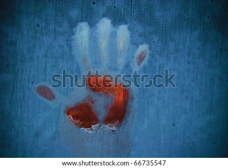 Slightly blurred bloody handprint on a frozen window (symbolizing horror or fear) - stock photo