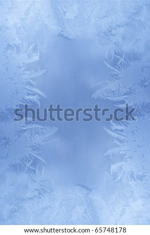 Slightly blurred frost pattern on a window glass (with empty space for your text or image) - stock photo