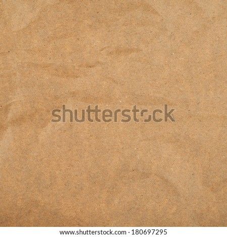 Slightly creased cheap brown packaging paper texture background - stock photo