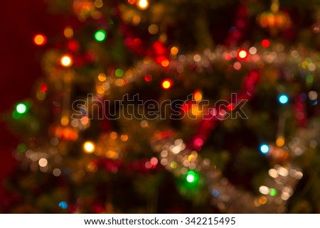 Slightly defocused real horizontal Christmas background with small sized colorful bokeh - stock photo