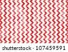Slightly grunged image of a zig-zag / chevron pattern. - stock photo