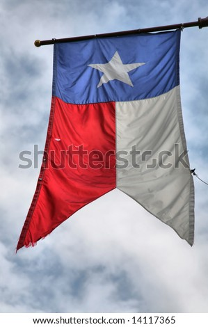 Slightly Tattered Texas Lone Star Flag - stock photo