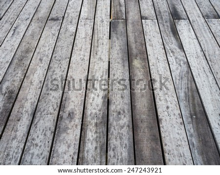 Slightly wet, grey wooden decking background - stock photo