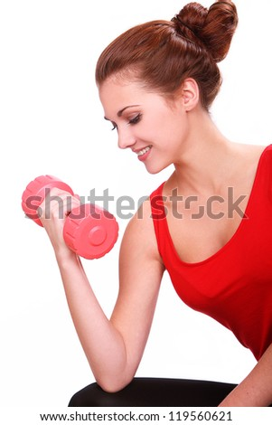 Slim and sporty girl do exercise with red dumbbells