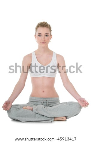 Slim attractive young woman doing yoga, easy / Sukhasana position, isolated on white background - stock photo