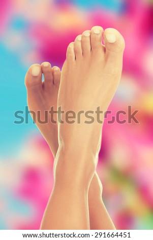 Slim beautiful nude woman feet - stock photo