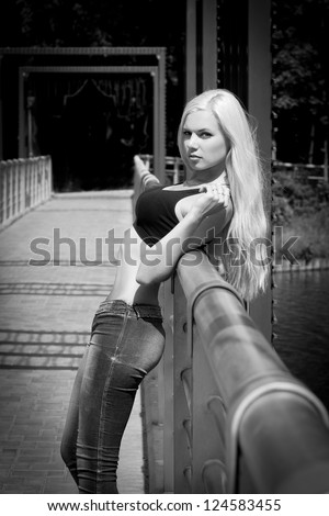 Slim blond model on the bridge - stock photo
