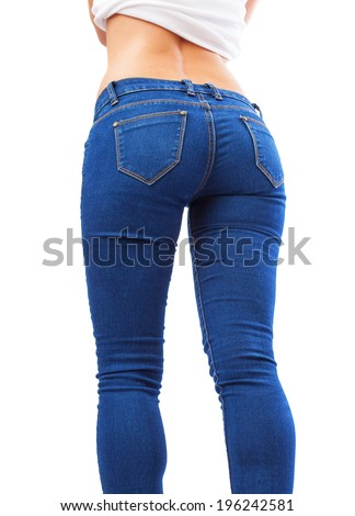 slim body of a pretty young woman wearing blue jeans - stock photo