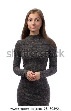 Slim charming girl in a gray dress in the studio, isolate on white. - stock photo