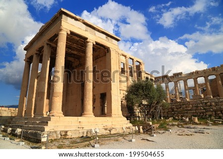 Slim columns of the Erechtheion temple on the North side of Athens Acropolis, Greece
