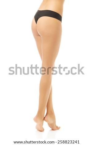 Slim female body in black panties - stock photo