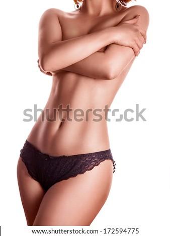 slim female in black panties on white background - stock photo