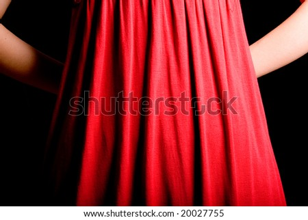 slim finger gesture on fresh red skirt