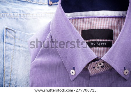 Slim fit shirt on jeans pants texture. No trademark - stock photo