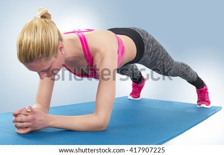 Slim fitness young woman Athlete girl doing plank exercise training workout crossfit gymnastics cross fit. - stock photo