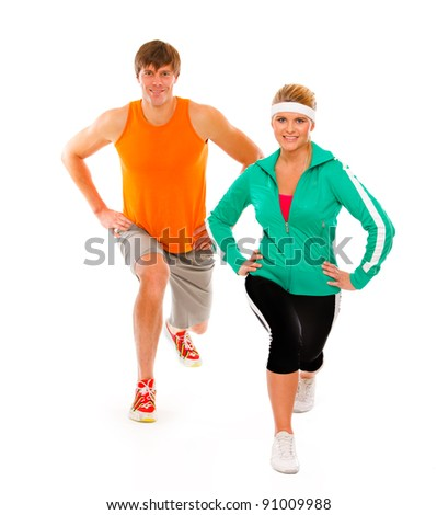 Slim girl in sportswear and man making sport exercises isolated on white