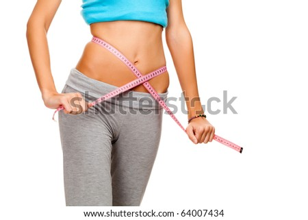 Slim girl with measuring tape - stock photo