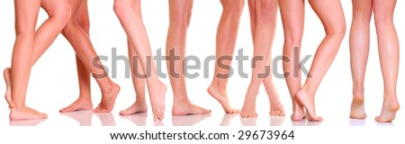 Slim legs of seven girls, isolated on a white background, please see some of my other parts of a body images: