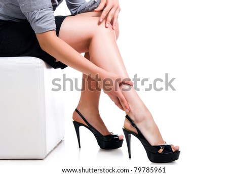Slim long sexy woman legs on white background - stock photo