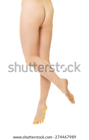 Slim nude woman legs and buttocks. - stock photo