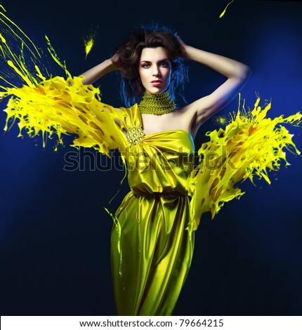 slim sexy woman in green dress and paint splash - stock photo