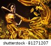 slim sexy woman in yellow fabric and leaves - stock photo