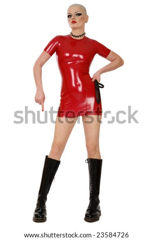 Slim skinhead woman in red latex dress and high boots over white background