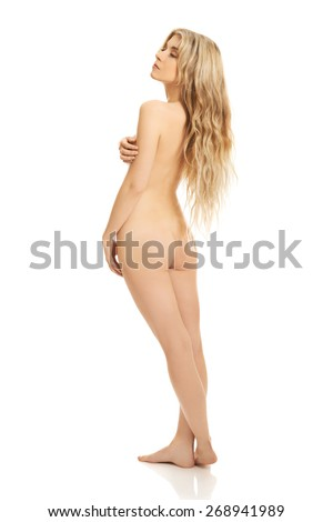 Slim spa woman standing and looking up. - stock photo