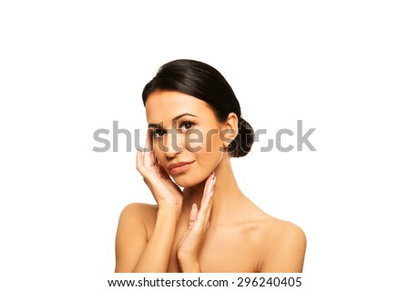 Slim spa woman touching her face - stock photo