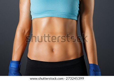 Slim sportive woman torso with strong abdominal  muscles - stock photo