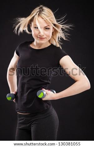 Slim sporty woman studio portrait - stock photo