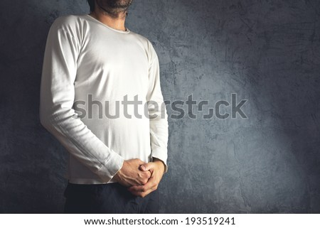 Slim tall man posing in blank white t-shirt as copy space for your text or design. - stock photo