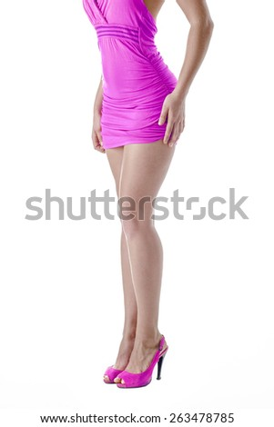 Slim tanned woman's body. Isolated over white background - stock photo