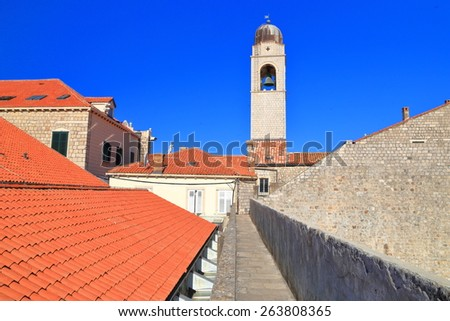 Slim tower dominates the old town of Dubrovnik with its orange roof tops, Croatia - stock photo