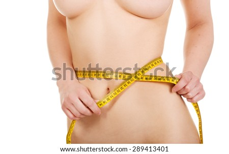 Slim undressed woman measuring her waist.