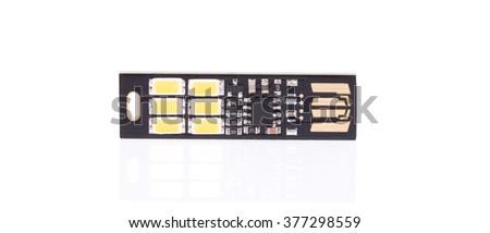 Slim USB flash drive isolated on white background - stock photo
