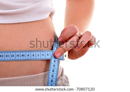 Slim waist with a tape measure around it - stock photo