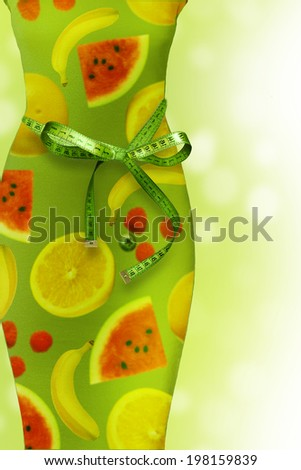 Slim waist with a tape measure. Healthy lifestyle concept.  - stock photo