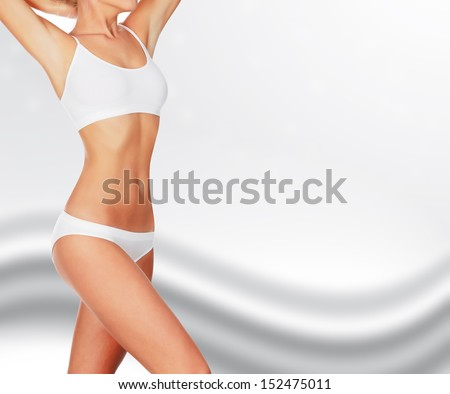 Slim woman against abstract background  - stock photo