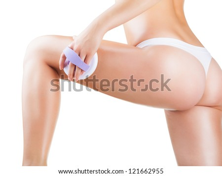 Slim woman doing cellulite massage isolated on white background - stock photo