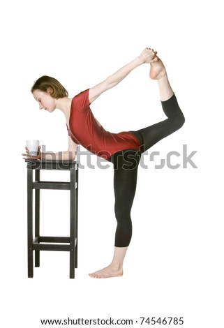 Slim woman drinking tea and stretching at the same time