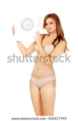 Slim woman holding a scale - stock photo
