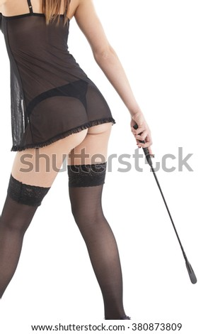 slim woman in underwear with a whip  - stock photo