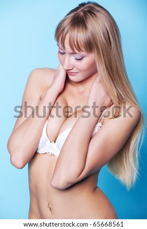 Slim woman isolated on blue background - stock photo